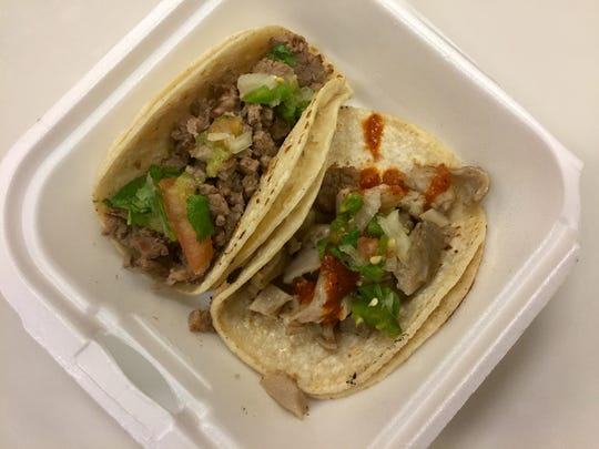 An asada taco, top, and a version filled with buche (pork stomach) are among the $1.50 tacos at Burrito Express.