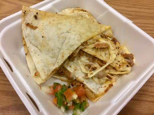 A pastor quesadilla (with traditional chunks of pineapple) at Burrito Express is made with an extra-large flour tortilla.