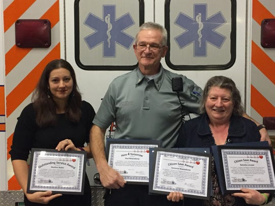 From left, 911 telecommunicator Heather Butler, First Aid and Safety Patrol Lieutenant Paul Newiadomy and Suzanne Newiadomy with awards they received from the First  Aid and Safety Patrol's Here4Tomorrow program. Suzanne Newiadomy is holding her daughter Natasha's award because Natasha was unable to attend the event.