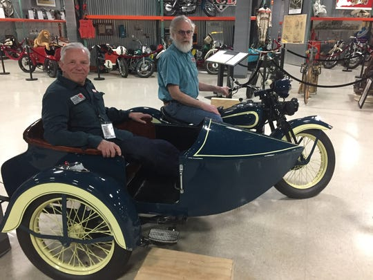 Dale Prusinowski of Rockland County, left, treasurer, archivist and member of the board of trustees at Motorcyclepedia, and Keith Jones of Hyde Park, archivist and Motorcyclepedia board member, pose with one of the museum's many motorcycles.