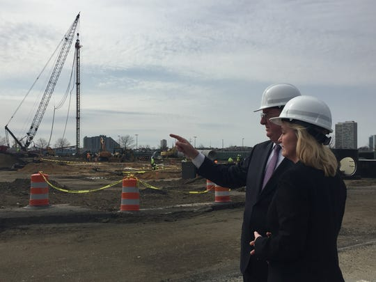 Developer Bill Hankowsky of Liberty Property Trust shows construction of the new Camden headquarters of American Water with company  president and CEO Susan Story as a rig drills for the building's concrete pilings  Monday.