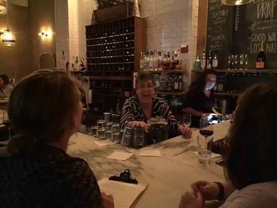 Monique Citro serves drinks Tuesday evening at Oak45