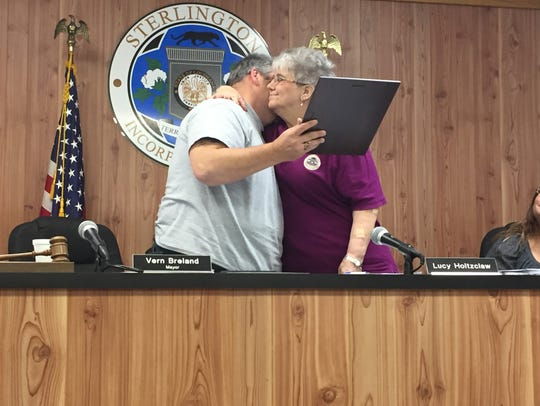 Sterlington Mayor Vern Breland hugs resigning Alderwoman
