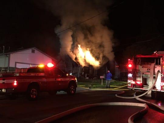 Redding firefighters battle a house fire that broke