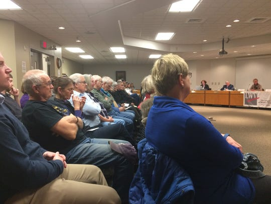 More than 70 people attended a voters forum to hear