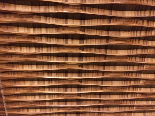 Custom-milled bamboo paneling at Tànsuŏ, a new Chinese