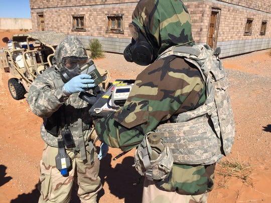 Soldiers with the 22nd CBRN Battalion check each other for contamination during a recent exercise.