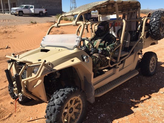A chemical soldier drives a Razor MRX-4 vehicle during a recent exercise at Fort Bliss.