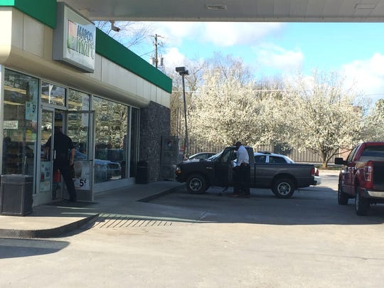 Authorities investigate an attempted armed robbery Friday, March 3, 2017, at the Mapco, 5412 Asheville Hwy. A woman was held by the store manager until authorities arrived.