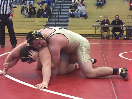 Delone's Bryce Perkins defeats Williams Valley's Ian Minnich, 7-4, in the 285-pound third place bout on Saturday.