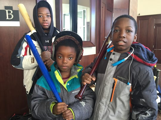 Asbury Park Little Leaguers Xavier Chathuant (left), Sarabi Alls (center) and Shakim Patterson (right) with donated equipment from the USABL.