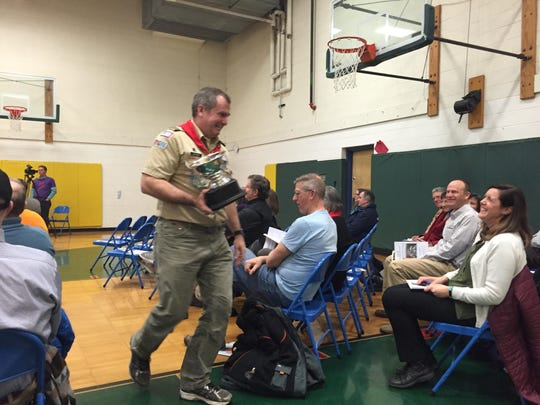 Jim Brangan, a firefighter and Boy Scout leader in Shelburne, was awarded the town's inaugural Colleen Haag Public Service Award at Monday's informational meeting at the Shelburne Community School. The award is named for the town's longtime clerk who retired last year.