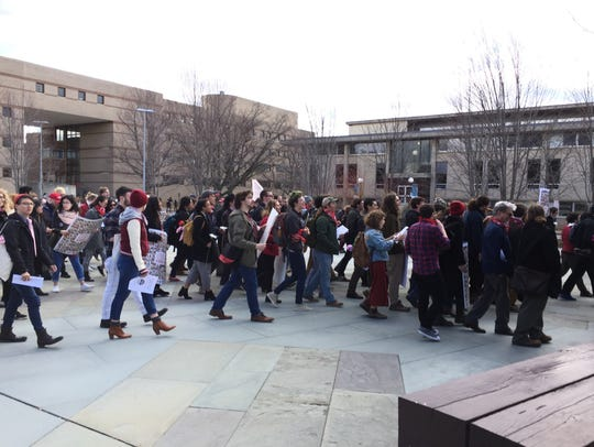 About 100 people attended a rally on March 8 to support