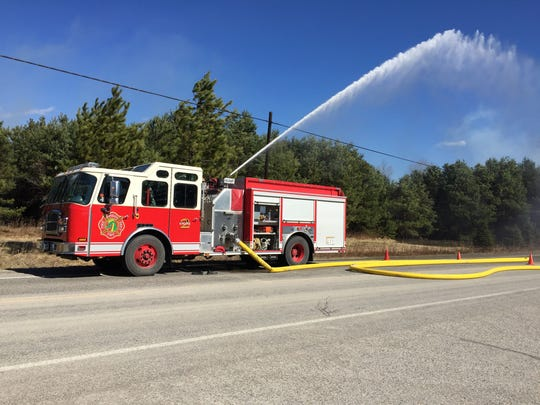 Firefighters are at the scene of a fire at Tollander Tree Farm in Kimball Township.