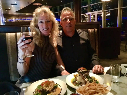 Recently retired west Redding UPS driver Cindy Cosby and her husband, Dave, celebrating at View 202.