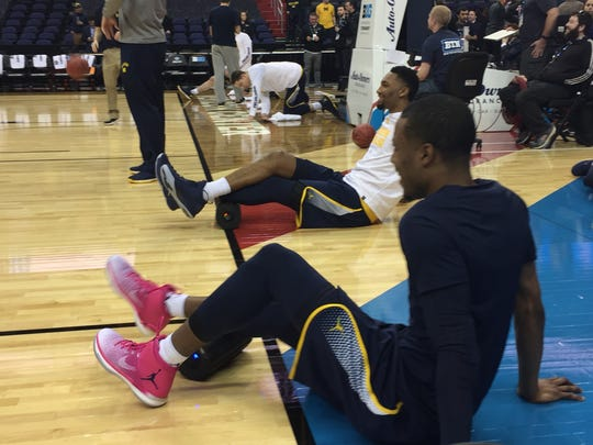 Muhammad-Ali Abdur-Rahkman and ZAk Irvin warm up in