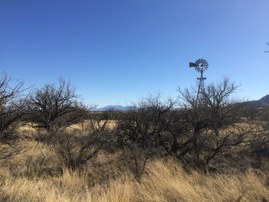 The Foothills Loop Trail takes hikers past a windmill before ascending into the foothills.