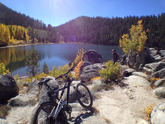 A mountain biker takes a break by Marlette Lake in