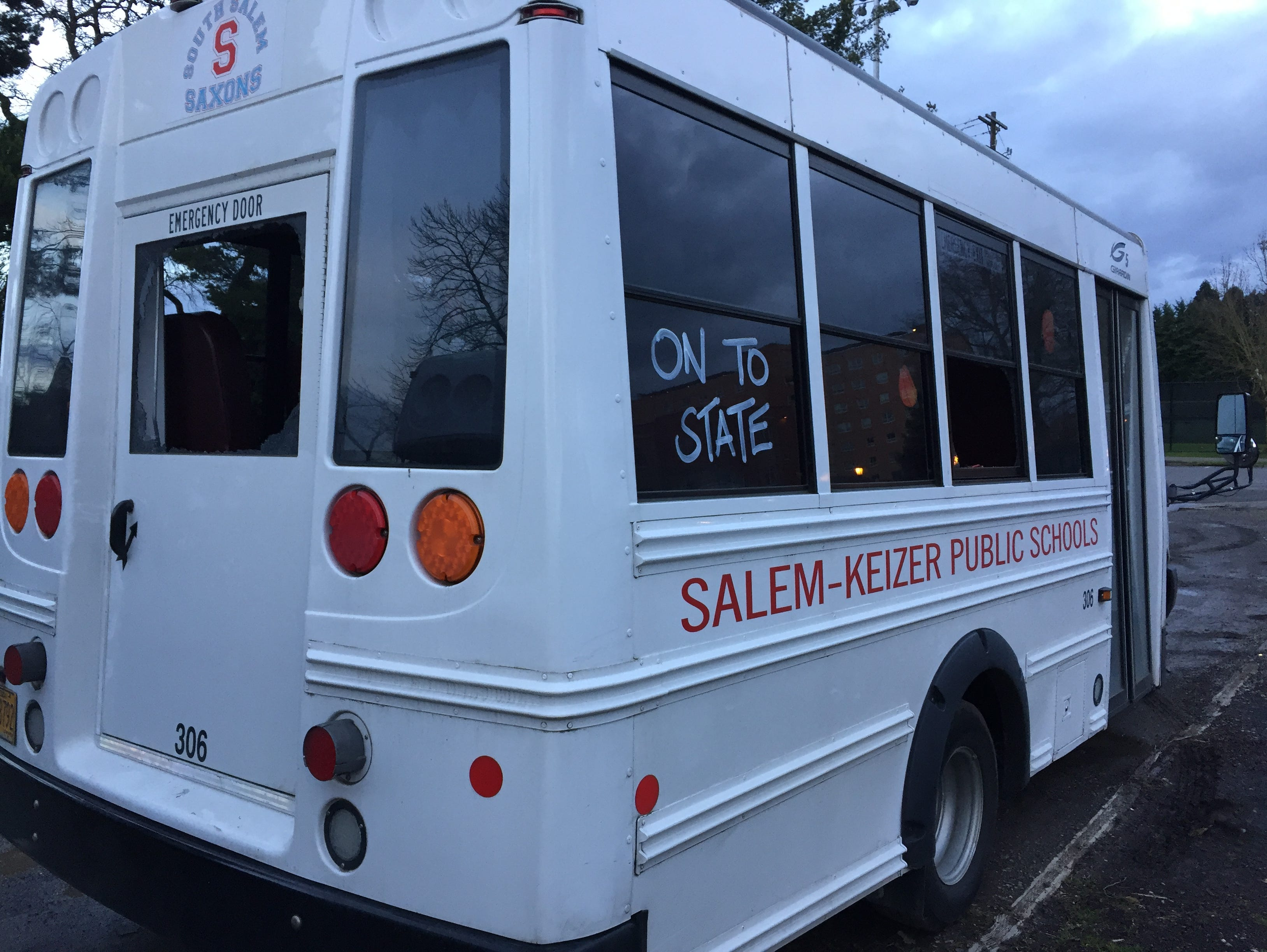 South Salem High School's team bus had the back and a side window smashed out by robbers Saturday.