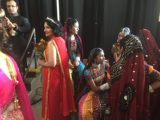 Ready to perform. Dancers prepare for their performance