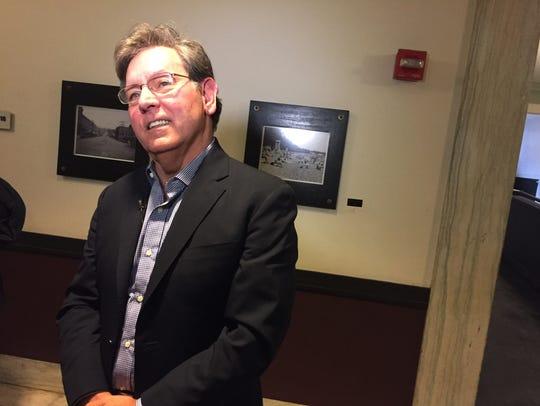 Burlington Town Center owner Don Sinex listens to questions