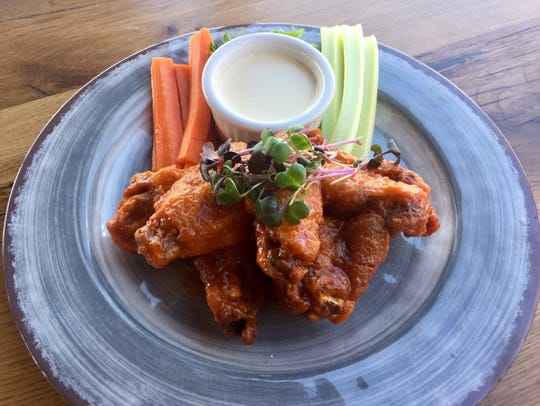 Local chicken wings in mango-infused barbecue sauce