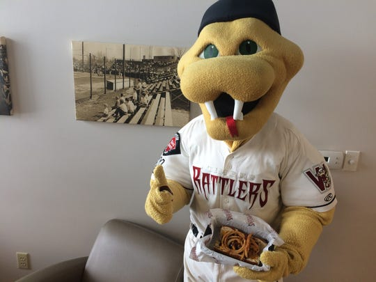 Fang is apparently already a fan of the Dinger Dog, this year's winner in the Timber Rattlers Fan's Choice Food Fight contest.