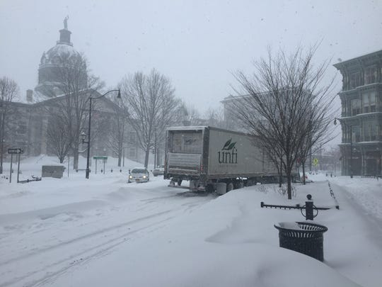 A tractor-trailer heading west on Court Street near