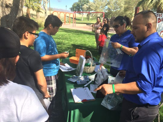 Participants get prizes and information at a Fight the Bite! block party in Indio on March 11, 2017.