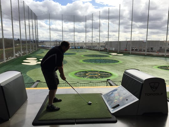 Dann Miller, consumer experience director for the Statesman Journal, prepares for his next shot on March 12, 2017, at TopGolf in Hillsboro.