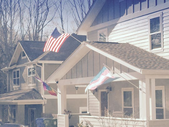 On the roof of the Montford home of Tina Madison White flies an LGBT pride flag, an American flag and a transgender pride flag.
