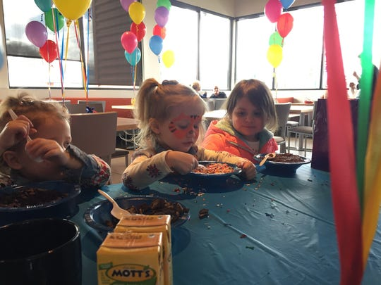 Kids are the stars of the show on Wednesdays at Rockhill in Cherry Hill. Here, Charlie Welder, Ellie Welder and Claire Murphy help themselves to a Sunday Bar at Charlie's and Ellie's third birthday party.
