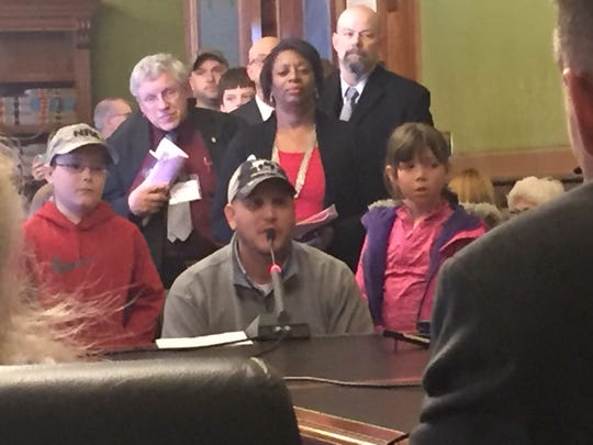 An Ankeny father brings his young son and daughter to the Capitol to argue for relaxing Iowa's gun laws.
