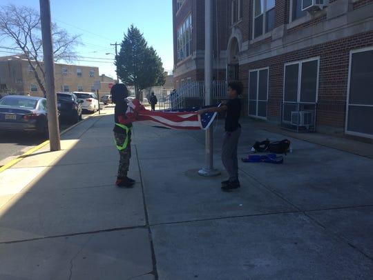 R.D. Wood Elementary School students fold the U.S.