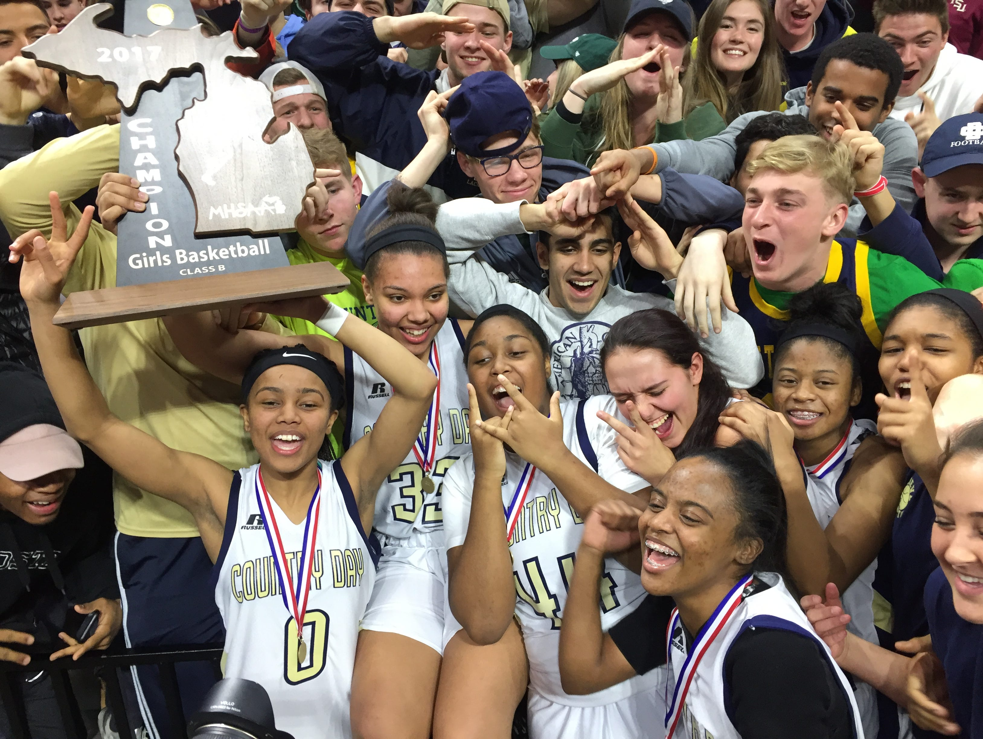 Birmingham Detroit Country Day celebrates its Class B state title after beating Ypsilanti Arbor Prep Saturday in East Lansing.
