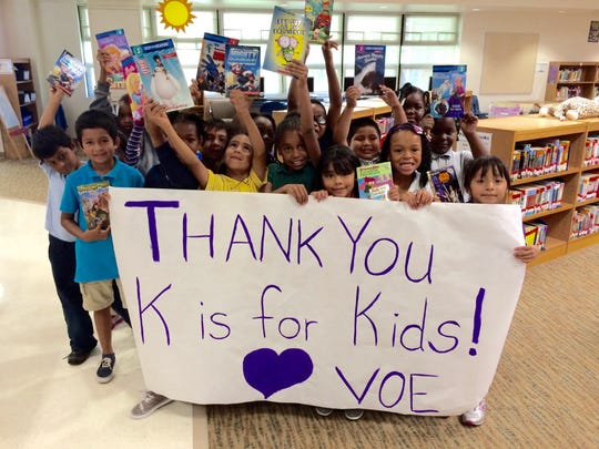 "Students at Village Oaks Elementary School in Immokalee show their appreciation after receiving books paid for by K is for Kids' ""Bring a Book, Bring a Friend Fun'raiser."""
