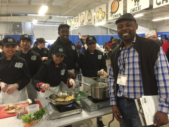 Burlington High School's Team Fork in the Road, winners of the p.m. Mise En Place award, with District Superintendent Yaw Obeng. H was a judge this year at the Jr. Iron Chef Vermont competition on March 18, 2017.
