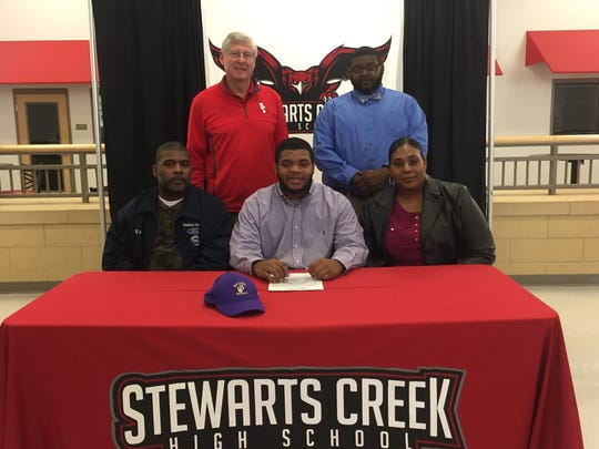 Stewarts Creek football standout Marcus Clemons recently signed to play at Bethel University. Pictured in the front row (l-r) are Shamar Clemons (father), Marcus Clemons and Sonja Clemons (mother). In the back row are Stewarts Creek coach David Martin and Marcel Clemons.