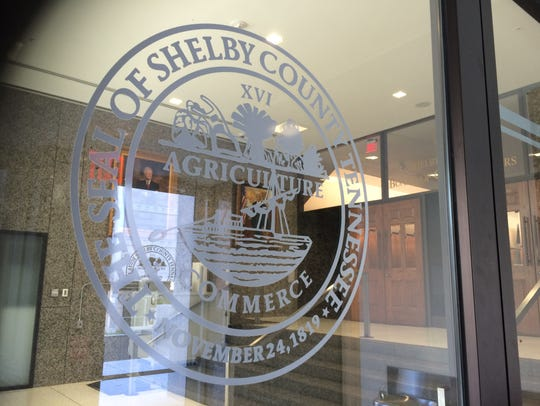 The Shelby County seal adorns the doors leading to