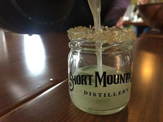 Simple syrup is accompanied by freshly squeezed lime, lemon and orange juices to make this Short Mountain Moonshine version of a margarita.