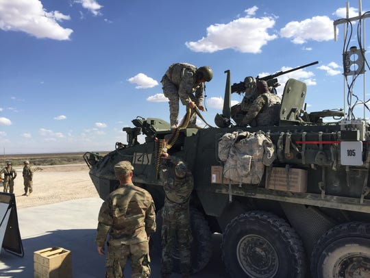 Soldiers from 3-41 Infantry unload ammo during the