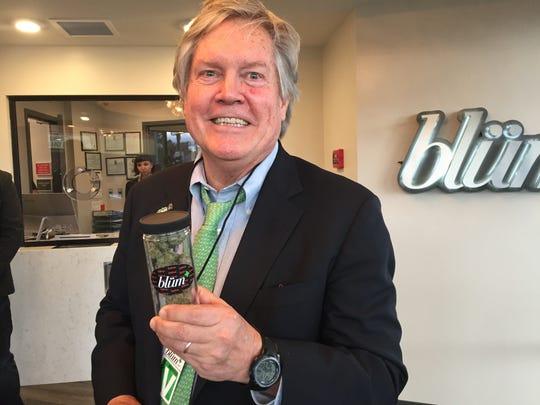 "Sen. Tick Segerblom, D-Las Vegas, co-sponsor of Senate Bill 302 holds a strain of marijuana named after him, the ""Segerblom Haze"" at Blum medical marijuana dispensary on Friday."