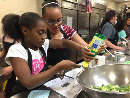 Kennedy Gordon, left, and Aleeya Johnson mix up ingredients for Greek couscous, one of the winning dishes at the John Pittard Elementary Junior Chef Academy cook-off, held Thursday, March 23, 2017.