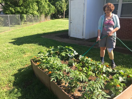 Susan Boatwright waters her garden that was planted with the help of Lutheran Services in Tennessee. Susan Boatwright waters her garden that was planted with the help of Lutheran Services in Tennessee.