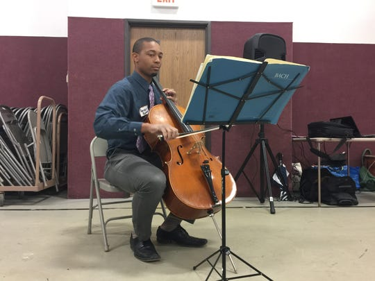 Xavier Quinn plays his cello Saturday at the ceremony that merged Hip Hope Inc. with the Jane Foundation. Quinn, an orchestra teacher in West Des Moines, hopes kids take advantage of the opportunities provided by them by Hip Hope Inc.