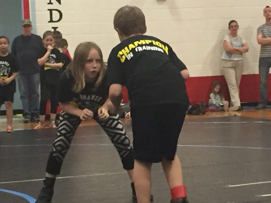 Reegan McClary (left) prepares to take on Michael Williams in a match.