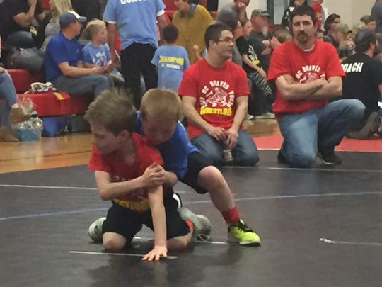 Jhase Duncan (left) and Hunter Dayberry (right) wrestle against each other during the tournament.