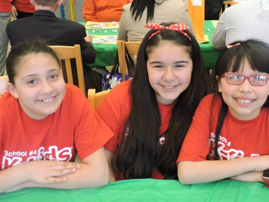 School No. 4 K-Kids members Jocelyn Nova, Isabella Mora and Ashley Giraldo are ready to begin the K-Kids meeting with the Linden Kiwanis members.