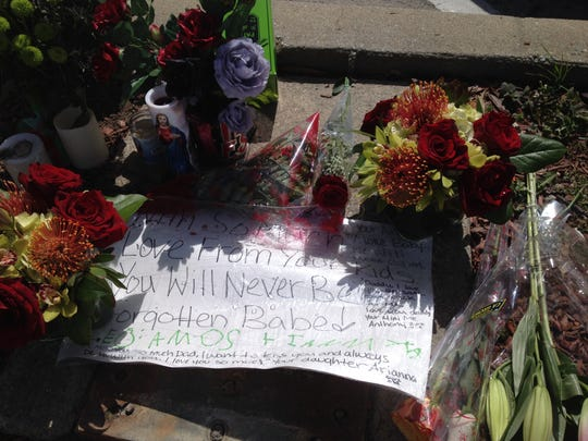 A memorial featuring notes from the loved ones of Jess Carl Gonzales mark where he was killed on Thursday.
