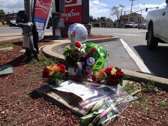 A memorial with toys, balloons and messages mark where a man was killed on Thursday in Salinas.